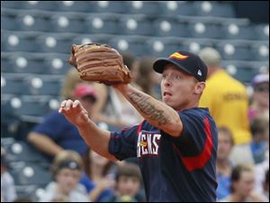 Toledo third baseman Brandon Inge makes a play in the first inning against  the Indianapolis Indians.