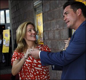 Author Kathryn Stockett, left, and director/screenwriter Tate Taylor joke around while speaking to reporters at a benefit screening of 'The Help' July 30 in Madison, Miss. The film is based on the New York Times best-selling book by Stockett about the lives of three women in the 1960s Mississippi.