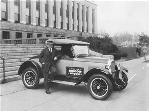 John North Willys, president of Willys-Overland Inc., leans on the 100,000th Whippet -- a Whippet Collegiate Roadster -- off the Toledo assembly line in May, 1927, in front of the plant's administration building.