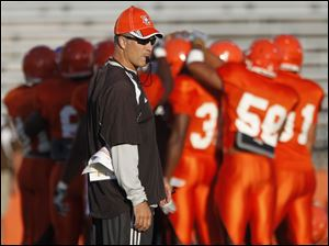 BGSU head football coach Dave Clawson oversees the Falcons' first scrimmage of the fall practice season Wednesday night.