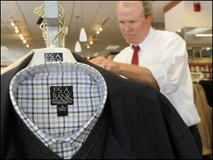 Attorney Bruce Powell shops at a Joseph A. Banks clothing store in