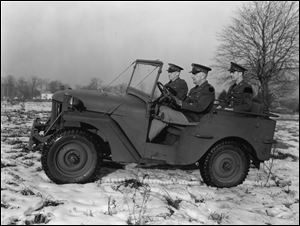 U.S. Army personnel drive a Willys-built Army Jeep in this Dec. 7, 1940, file photo.