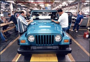 1996: Ken Wieland and Dave Pixley put the finishing touches on the first Wrangler TJ to come off the line at the Stickney Avenue Jeep plant.