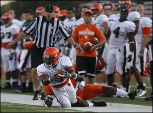 Wide receiver Eugene Cooper is tackled after making a catch in Bowling Green's scrimmage Wednesday night.