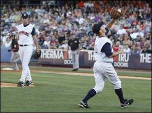 Toledo third baseman Brandon Inge catches the pop-up to make an out on Louisville Bats player Kristopher Negron in the third inning.