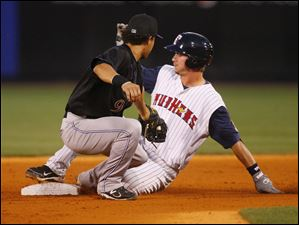 Toledo's Ryan Strieby (55) slides safely into second with a double as Louisville's Kristopher Negron (9) is late with the tag.