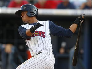 Toledo Mud Hens player Argenis Diaz hits a double in the third inning against the Louisville Bats.