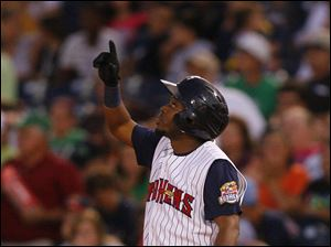 Mud Hens player Timo Perez points to the sky after hitting a single.