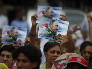 People attend a birthday celebration marking the 85th birthday of Cuba's leader Fidel Castro in Managua, Nicaragua.