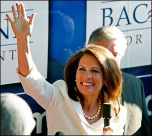 Michele Bachmann waves to supporters from her campaign bus after being named the winner of the straw poll.