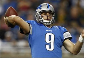 Detroit Lions quarterback Matthew Stafford throws a seven-yard touchdown pass to Nate Burleson against the Cincinnati Bengals during the first quarter of an NFL preseason football game in Detroit.