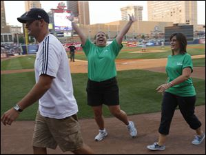 Kelly Techmire, center, says hi to friends after playing a game with Scott Floyd, left, and Brenda Donaldson.