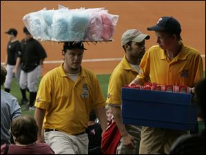 Matthew Blakemore, Brandon Harris, and Randy Kopke sell cotton candy and popcorn.