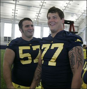 Above, Wauseon's Elliott Mealer, left, clowns around with fellow lineman Taylor Lewan.