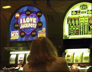 Slot-machines are designed to 'make you play faster, longer and more,' a state problem-gambling official says. But Penn National says there's no sinister motive.