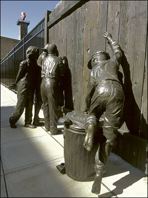 The statue, incorporated into the fence around Fifth Third Field, was created by local artist Emanuel Enriquez and installed in 2002. In the early morning hours of Saturday, two Toledo police officers found part of the statue, a little girl in pigtails, about 20 yards from its original location. The officers booked the statue into the property room for safekeeping, but apparently nobody informed Mud Hens officials or the Arts Commission of Greater Toledo.