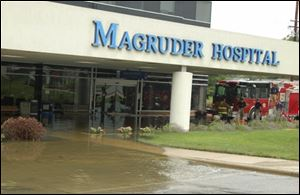 Port Clinton firefighters examine water damage to H. B. Magruder Hospital, which