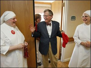Mr. Gee, center, visits with Sister Raymond Kortenhof, left, and Mother Cecilia.