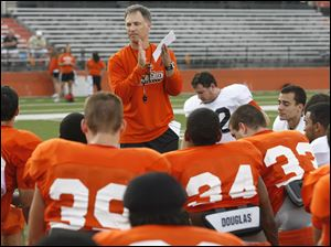 Head coach Dave Clawson talks to his team before the Bowling Green State University football scrimmage Thursday, 08/18/11, at Doyt Perry Stadium in Bowling Green, Ohio.