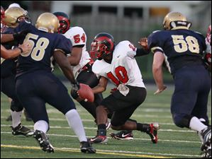 Rogers QB D.J. Tucker (10) attempts to move the ball through St. John's defense during the Shoe Bowl on Friday, Aug. 19.