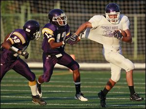 Fremont Ross running back Hunter Trautwein (26) eludes Waite's DeVonte Hughes (13) and Jermaine Walker (18.