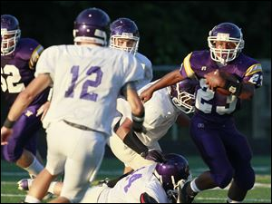 Waite running back James Johnson (23) eludes Fremont Ross defenders.