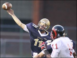 St. John's quarterback Brogan Roback launches a pass against Rogers during the Shoe Bowl.
