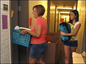 Toledo resident Sandi Zwayer helps her freshman daughter, Kari Zwayer, move into her dorm room at BGSU.