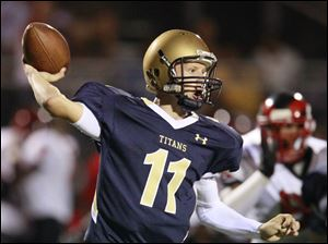 St. John's quarterback Brogan Roback throws the ball against Rogers during the Shoe Bowl in Ottawa Hills.