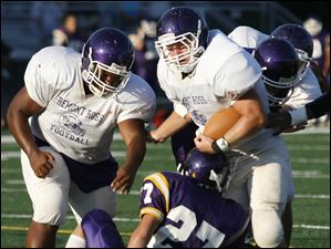 Fremont Ross FB Trent Stout (45) scores a touchdown against Waite's Kenny Hade (27) Friday, Aug. 19 during the Shoe Bowl in Ottawa Hills.
