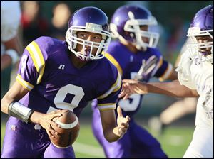 Waite quarterback Johnny Douanglee (9) carries the ball down the field.