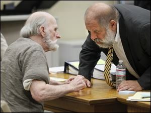 Robert Bowman confers with attorney Pete Rost  during his trial in Lucas County Common Pleas Court, Friday, August 19, 2011.  He is accused of killing of 14-year-old Eileen Adams in 1967.  Bowman decided not to testify and the defense rested on Friday.