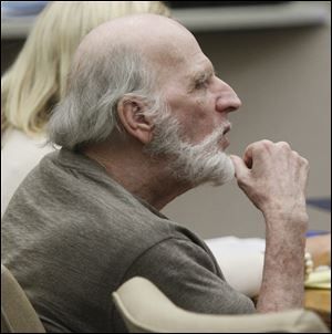 Robert Bowman listens to testimony during the trial. His defense is expected to begin presenting witnesses Friday.