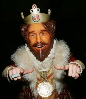 "Burger King mascot, The King poses in the green room during the ""Jimmy Kimmel Live"" Show at Super Bowl XL February 3, 2006 at the Gem Theatre in Detroit, Michigan."