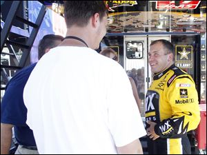 NASCAR driver Ryan Newman, right, talks with fans near his trailer at MIS.