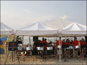 The Glass City Steel band plays during the Barefoot at the Beach party.