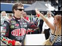 Jeff Gordon hi-fives a fan on his way to driver introductions during the Pure Michigan 400 at Michigan International Speedway.