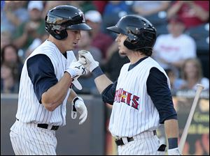 Second baseman Will Rhymes, right, congratulates Andy Dirks on a home run during the bottom of the fifth inning.