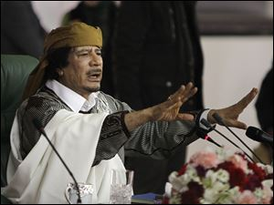 Libyan Leader Moammar Gadhafi, seen here in this March 2011 photo, has disappeared since the rebels made a push toward Tripoli.
