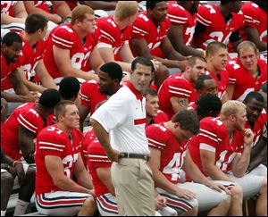 Ohio State coach Luke Fickell waits with his team during yesterday's media day at Ohio Stadium. The Buckeyes open Sept. 3 against Akron.