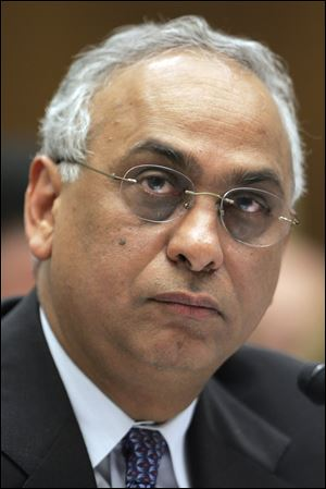 Standard and Poor's President Deven Sharma testifies on Capitol Hill in Washington in 2008. The McGraw-Hill Cos., the parent of S&P, on Monday, Aug. 22, 2011 said Sharma is stepping down, an announcement coming only weeks after the rating agency's unprecedented move to strip the United States of its AAA credit rating.
