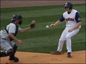 The Hens' Scott Thorman was able to get around Buffalo's Raul Chavez at the plate to score.