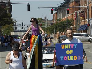 Marchers call for unity during the Toledo Gay Pride parade in downtown.