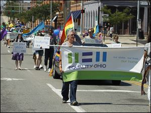Equality Ohio is one of the many organizations that marched during the Toledo Gay Pride parade.