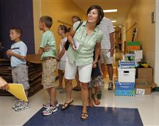 Tricia-Cowell-looks-in-new-room-at-Beverly-School