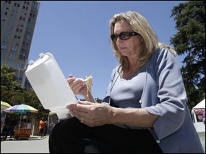 In this July 20 photo, D'Anne Ousley has lunch out of a plastic foam container in Sacramento. A measure by state Sen. Alan Lowenthal ( D., Long Beach) if approved by the legislature and signed by Gov. Jerry Brown, would prohibit restaurants, grocery stores and other venders from dispensing food in expanded polystyrene containers, commonly known as Styrofoam, beginning in 2016.