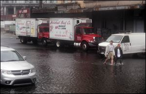 In New York City's Meatpacking District, Irene lightly flooded 10th Avenue. In many areas, standing water was quickly receding.