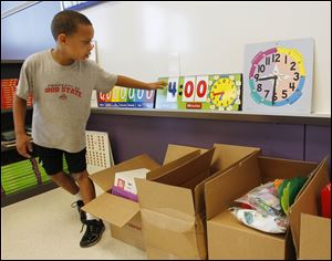 Devon Sanders checks his Beverly classroom. Many students and teachers spent time in temporary spaces.