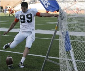 Kicker Kyle Burkhardt practices kicking during Bowling Green University football scrimmage.