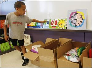 Second grader Devon Sanders checks out his classroom during a tour of the new Beverly Elementary School.